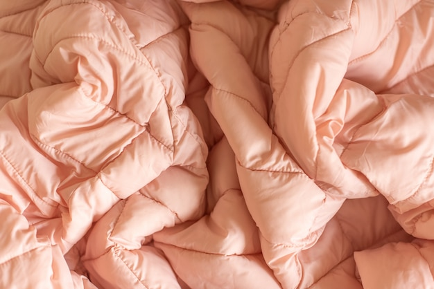 Down jacket fabric background, pink puffer jacket texture