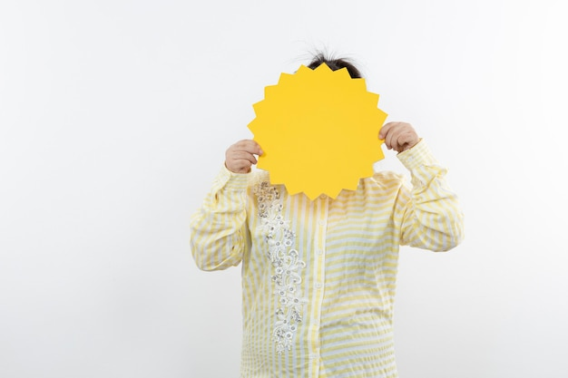 Down syndrome girl in eyeglasses standing with blank speech bubble.