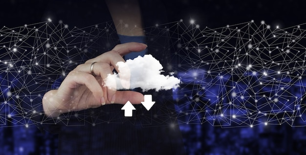Download data storage business technology network concept. hand hold digital hologram cloud, download, data sign on city dark blurred background.