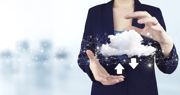 Download data storage business technology network concept. two hand holding virtual holographic cloud, download, data icon with light blurred background.