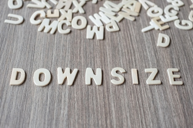 Downsize word of wooden alphabet letters. business and idea concept