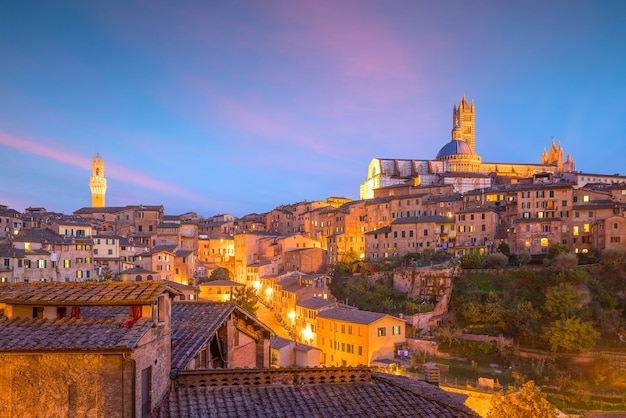 Downtown siena skyline in italy with beautiful sunset