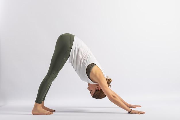 Downward dog pose (adho mukha svanasana) yoga postures (asana)