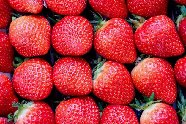 Dozen of fresh red strawberries