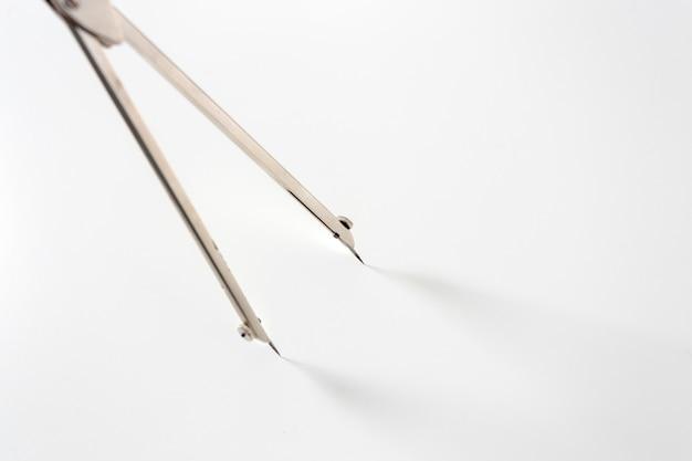 Drafting instrument on white macro