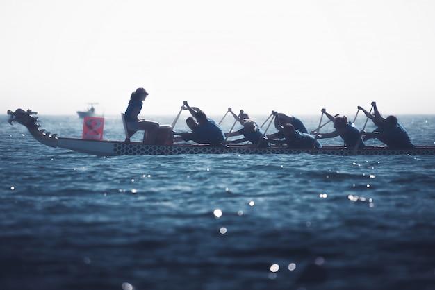 Dragon boat crew silhouette