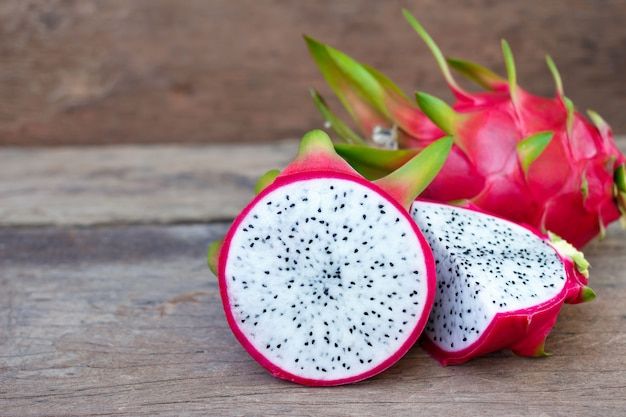 Dragon fruit on old wooden table