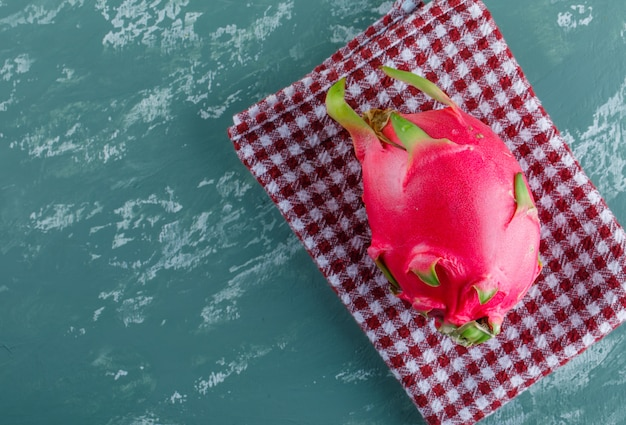 Dragon fruit on plaster and picnic cloth. flat lay.