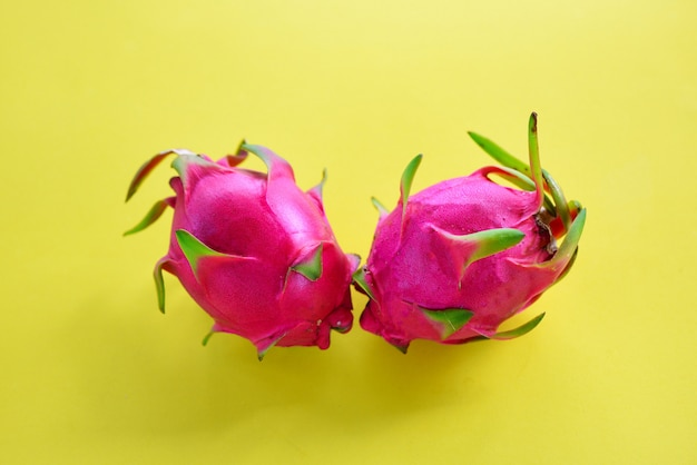 Dragon fruit slice on yellow background  fresh pitaya summer tropical fruit