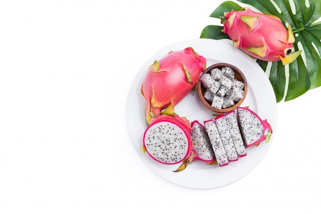 Dragon fruit tropical , pitaya slice on white dish isolated on white,  with clipping path