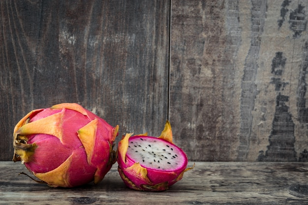 Dragon fruit on wooden table copyspace
