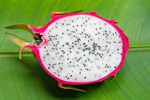 Dragonfruit or pitahaya on banana leaf background.