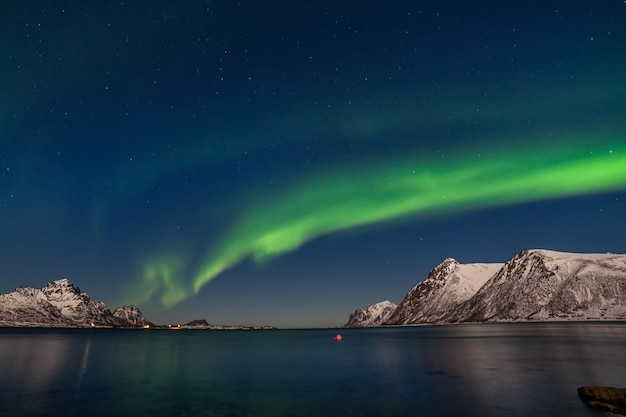 Dramatic aurora borealis, polar lights, over mountains in the north of europe - lofoten islands, norway