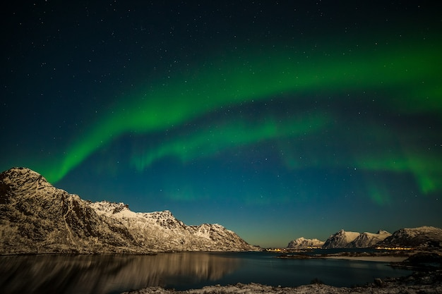 Dramatic aurora borealis, polar lights, over mountains in the north of europe