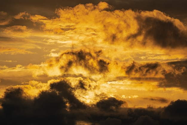 Dramatic clouds illuminated rising of sun in sky to weather change. natural weather conditions background. soft focus, motion blur. cloudscape image ready for design, replace sky in photo editor.