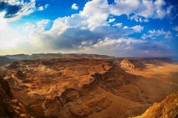 The dramatic landscape, dark blue sky above mountain masada in israel.