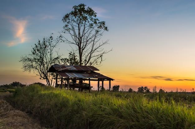Dramatic landscape hut with sunset sky nature background.