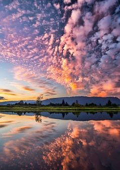 Dramatic pink clouds reflection