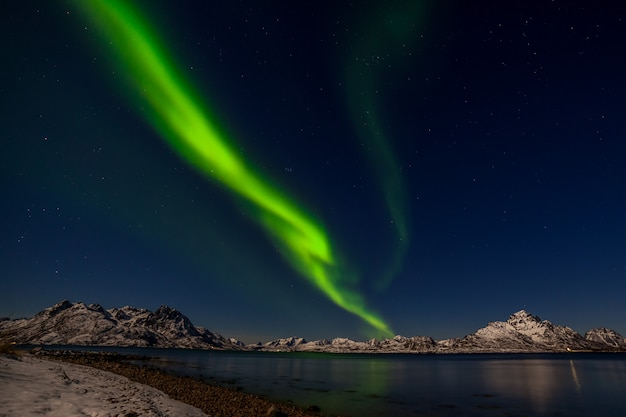 Dramatic polar lights, aurora borealis over the mountains in the north of europe - lofoten islands, norway