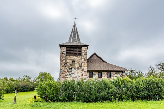Dramatic sky over the historic st andrews anglican stone church in heward sk