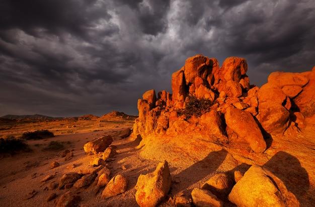 Dramatic sunset scene in gobi stone desert, mongolia