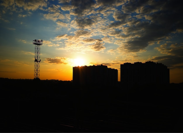 Dramatic sunset silhouette of two buildings background