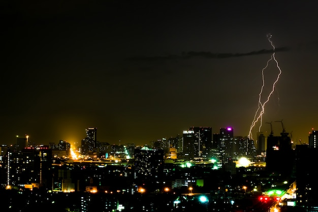 Dramatic thunder storm in the city at night