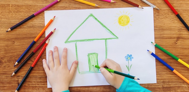 Draw child house family. selective focus.