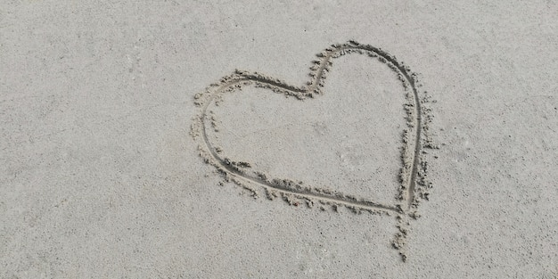 Draw heart on the sand.