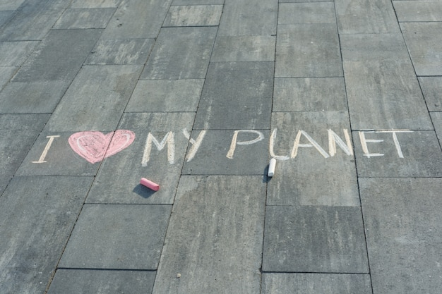 Drawing on asphalt text - i love my planet
