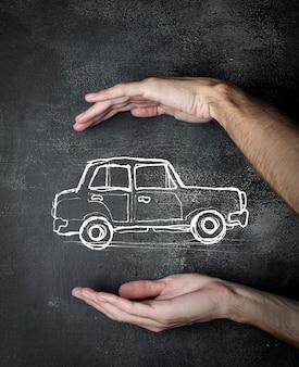 Drawing of a car between hands