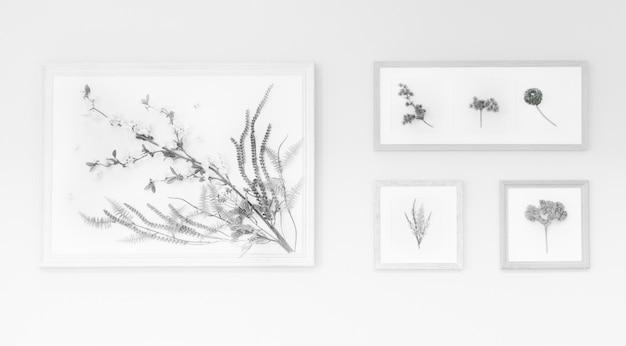 壁のフレームの中に花を描く