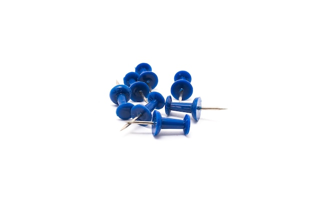Drawing pins concrete buttonscarnations blue isolated on white background