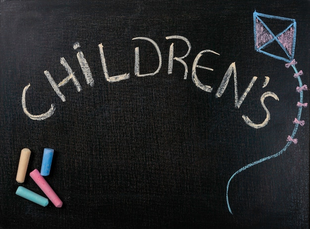 Drawing on sandpaper. children's day and colored chalk