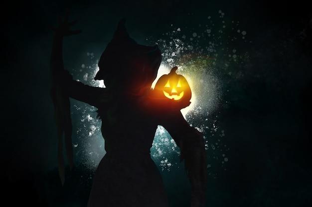 魔女と燃えるカボチャのジャックランタンのシルエットを描く