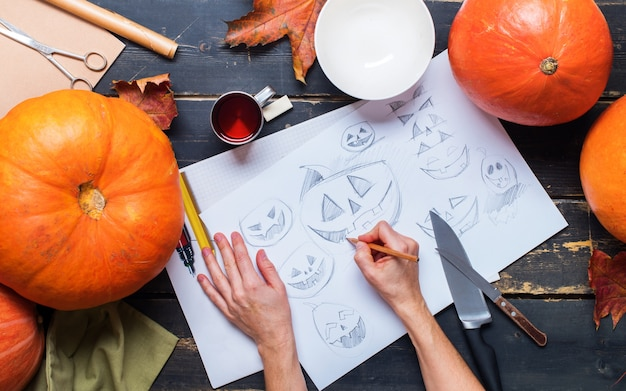 Drawing sketch character with hands pumpkin knife