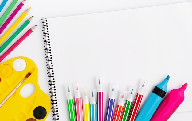 Drawing supplies and scetchbook on white background. top view, copy space