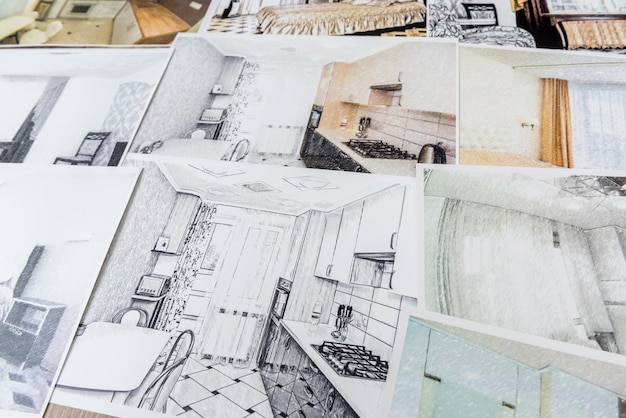 Drawings of a house or apartment are on the table. designer desk with graphic outline of apartment. architects project.