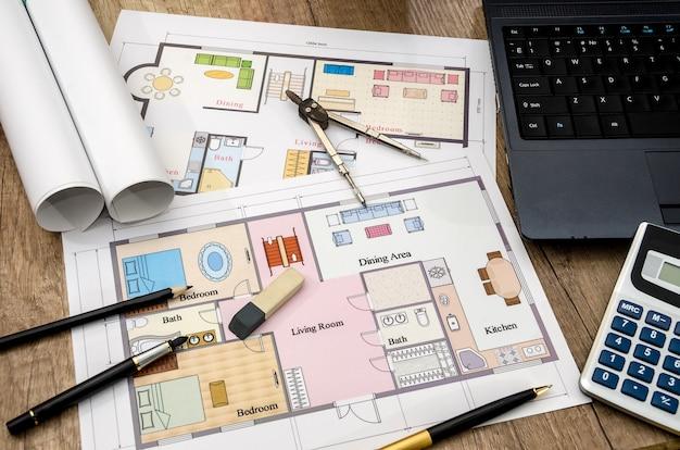 ノートパソコンと電卓を使った紙の絵