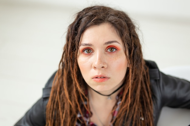 Dreadlocks hairdresser and style concept a funny girl with dreadlocks and in leather jacket