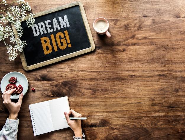 Dream big phrase written on a blackboard