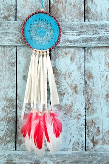 Dream catcher on shabby wooden background