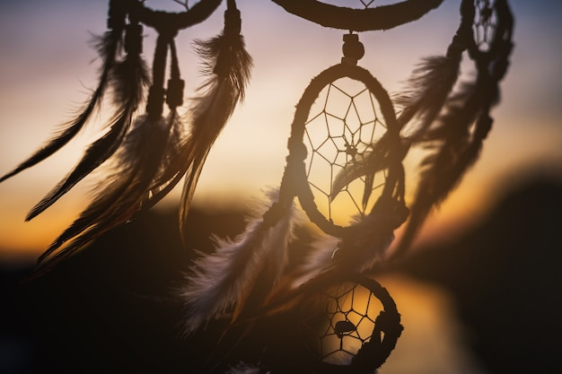 Dream catcher in the wind with beautiful  sunset