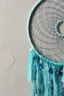 Dream catcher with blue threads