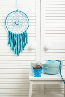 Dream catcher with blue turquoise threads