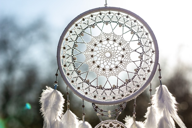 Dream catcher with feathers threads and beads rope hanging.