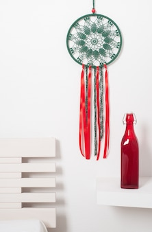 Dream catcher with green red laces