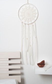Dream catcher with white feathers