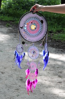 Dreamcatcher made of feathers, leather, beads, and ropes