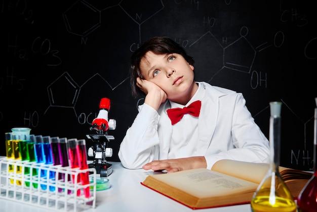 Dreaming little boy in laboratory